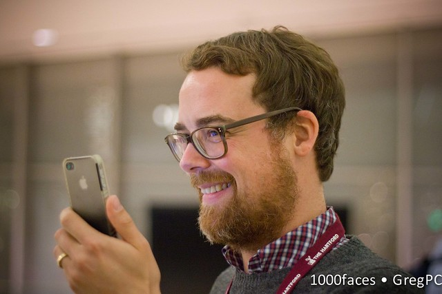 Face - bearded man taking a photo with his iPhone