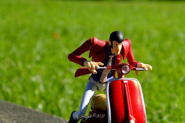 Revoltech Lupin on red Freeing scooter