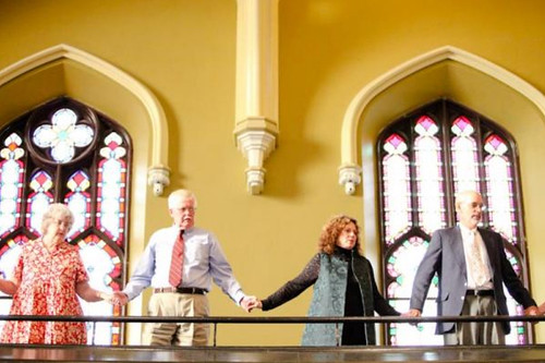 We asked our guests to hold hands for the closing. These were some of the guests up in the balcony.
