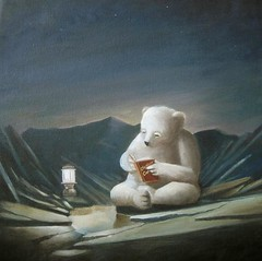 Mr polar bear sits alone reading christmas car...