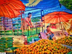 Selling Oranges at the Local Market Ban Kruat ...