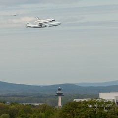 Discovery and chase plane over Dulles Tower