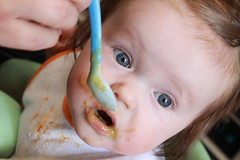 Baby Eating Green Beans From A Spoon And It Is...