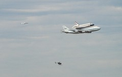 Discovery, chase plane and helicopter