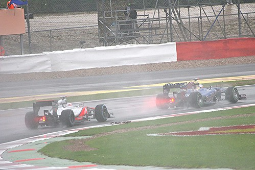 Jenson Button catches Jean-Eric Vergne at Silverstone