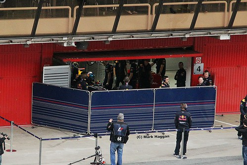 Sebastian Vettel gets into his Red Bull at Formula One Winter Testing, Circuit de Catalunya, March 2012