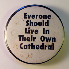Situationist slogan badge