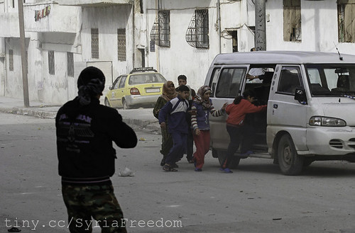 Civilians flee from fighting after Syrian army...