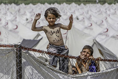 Thousands of Syrian refugees have poured over the border into Turkey and Lebanon to escape the terror. A young refugee settles into a new life at a camp in Boynuyogun, Turkey.
