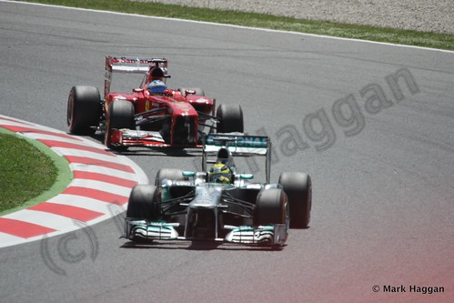 Lewis Hamilton and Fernando Alonso in the 2013 Spanish Grand Prix