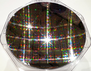 Hot off the press — the latest D-Wave wafer of quantum processors and TIME cover story