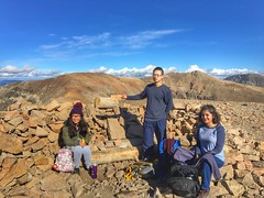 From left to right: Xiaoen Ding, Hieu Nguyen, and Amandeep Vashisht on top of Mount Bross.