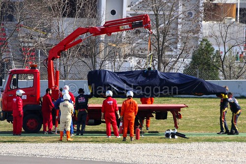 Max Verstappen's Toro Rosso is recovered after stopping on track during Formula One Winter Testing 2015