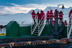 Passengers viewing sunset in Antarctica from the Bow of the MV Expedition