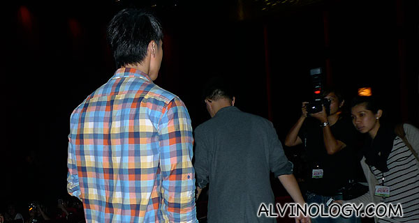 Wu Chun making his way to the front of the hall