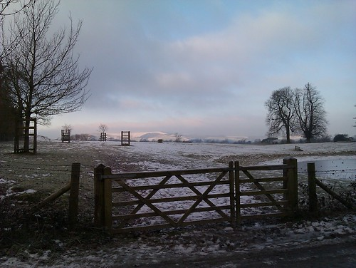 Snowy Firle Park gate with pond by CharliePev