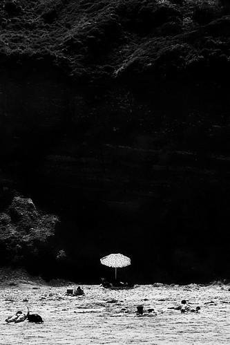 umbrella on cliff by Matt Hovey