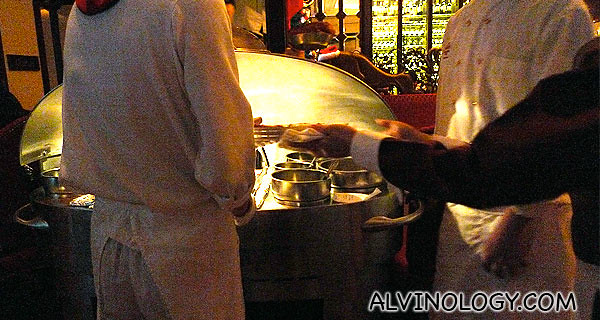 Lawry's steak chefs coming by our table with their grill and our steak in it