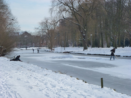 clearing snow for skating