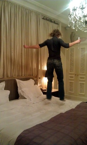 We've just checked into the Prestige suite at the Hôtel Plaza Athénée, Paris. yes, I'm jumping on the bed with my Alain Ducasse Champagne