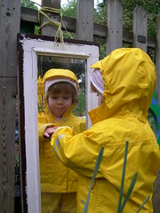 a child looking in a mirror sees a reflection