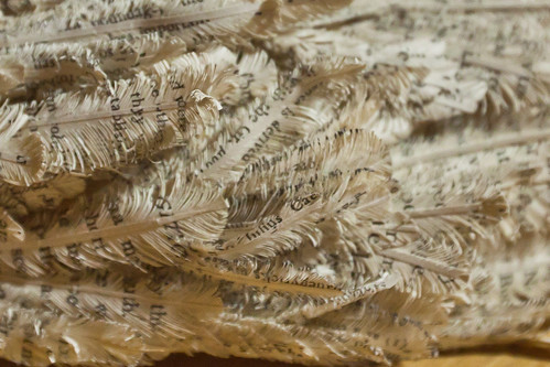 feathers carved from book pages