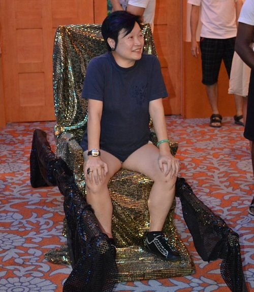 The Queen waiting to be carried onto her throne