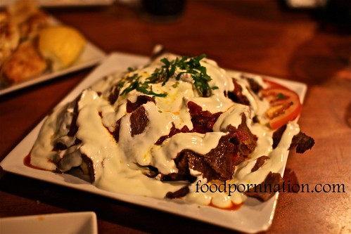 Iskender $12 - Doner Kebab meat served on a layer of Turkish bread topped with home made yoghurt and special red sauce @ Sultan's Table, Enmore