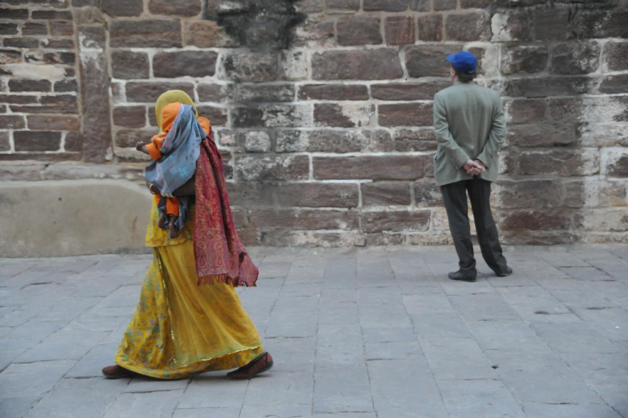 The musician mother after the day long singing at Mehrangarh fort, goes home with her child