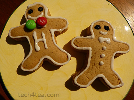 Two happy gingerbread men posing for the camera.