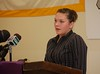 Kaytie Scully speaks at a podium on Jan. 17, 2012, at the release of Maine's strategic plan for education.