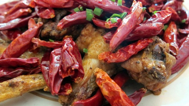 chili peppers and wings at misson chinese