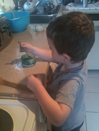 The mad scientist at work, colouring icing.