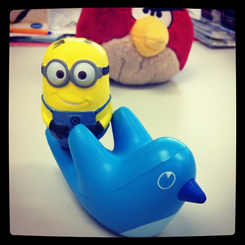 My desk mates: Minion on Twitter bird with an Angry Bird looking on.