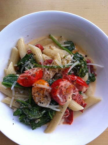 Pasta with tomatoes, peppers and wilted spinach