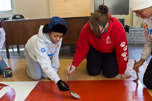 YouthBuild students and staff painting a mural for Opport-UNITY