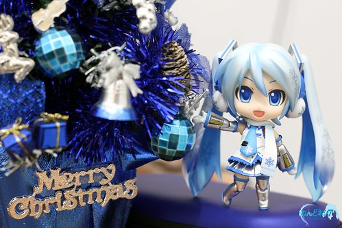 Snow Miku looks really happy looking at the Christmas tree