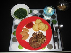 Rösti rounds, vegan hamburger, onion rings, poached pears and spinach