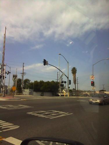 dangling street sign