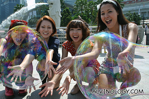 Jenny, Clara, Karren and Holly playing with large bubbles