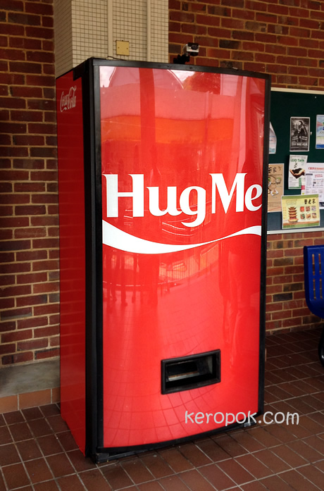 Hug Me Coke Machine