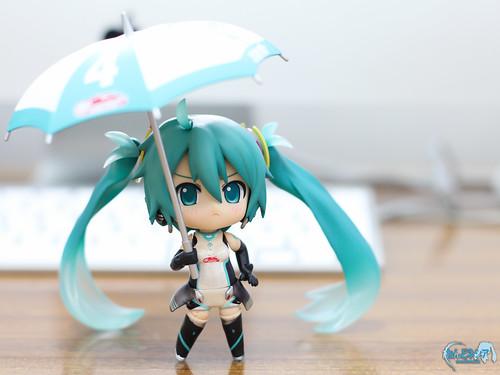 Holding the umbrella/parasol