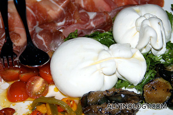 Burrata Cheese Served with Grilled Vegetables, Rucola Salad, Cherry Tomatoes and Parma Ham