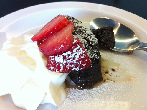 Half portion of Fresco Bistro's flourless chocolate cake dessert