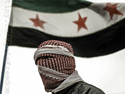 Syria Independence Flag behind a Free Syrian Army member