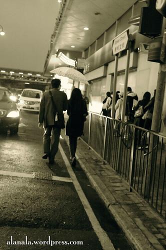 A couple, an umbrella