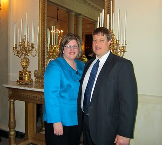 Alana Margeson and her husband, Erich, pose at the White House.
