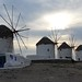 Five windmills alone on a beach