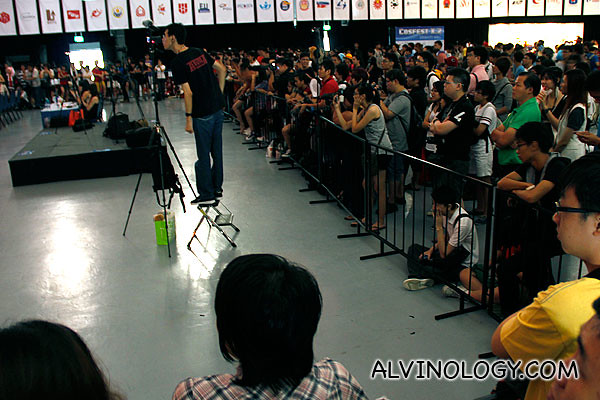 Lots of people taking photo and watching the stage performances
