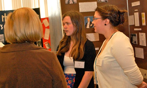 Two students present a historical exhibit on the Holocaust at Maine History Day.